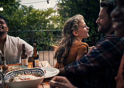 Buy stock photo Shot of an adorable little girl chatting with her father during a dinner party outdoors
