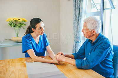 Buy stock photo Cropped shot of a compassionate young female nurse consoling a senior man in a nursing home