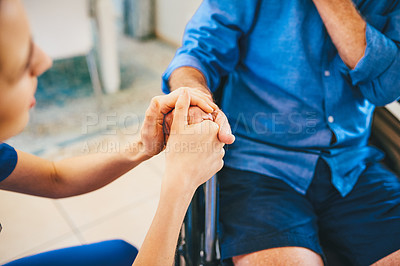 Buy stock photo Cropped shot of an unrecognizable female nurse consoling a senior man outdoors at a nursing home