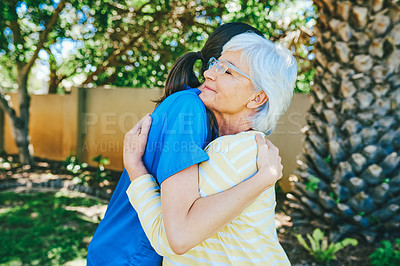 Buy stock photo Cropped shot of a senior woman hugging a female nurse outdoors at a nursing home