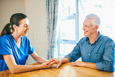 Buy stock photo Cropped shot of an attractive young female nurse having a chat with a senior man in a nursing home