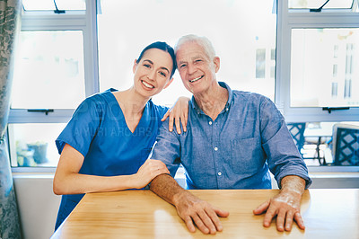 Buy stock photo Cropped portrait of a cheerful senior man smiling while sitting with a female nurse in a nursing home
