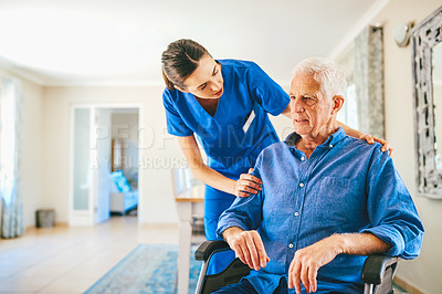 Buy stock photo Cropped shot of an attractive young female nurse talking to a senior man in a nursing home