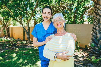 Buy stock photo Cropped portrait of a senior woman smiling while standing with a female nurse outdoors at a nursing home