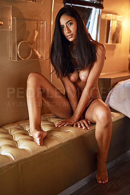 Buy stock photo A gorgeous young woman posing seductively in her bedroom