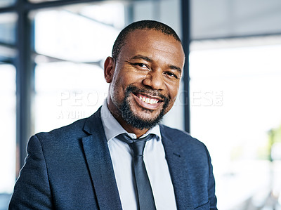 Buy stock photo Cropped portrait of a handsome middle aged businessman smiling while standing in a modern office