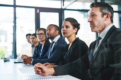 Buy stock photo Cropped shot of a diverse group of young businesspeople attending a conference