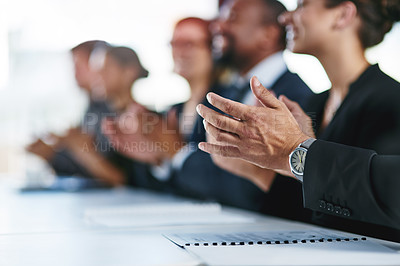 Buy stock photo Cropped shot of a group of unrecognizable businesspeople applauding at a conference