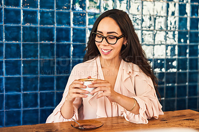 Buy stock photo Cropped shot of a beautiful young woman sitting in a coffee shop