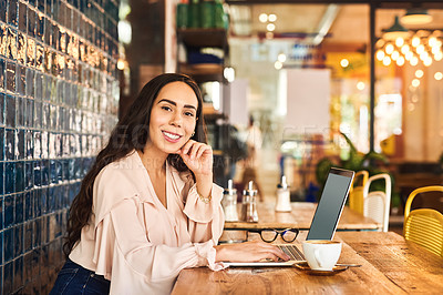 Buy stock photo Cropped shot of a woman using her laptop while sitting in a cafe