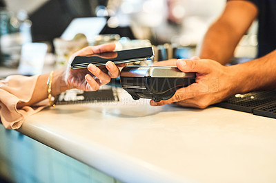 Buy stock photo Cropped shot of an unrecognizable woman making an nfc payment in a restaurant