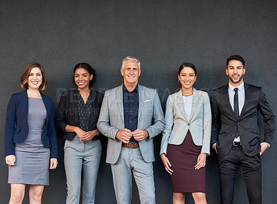 Buy stock photo Cropped portrait of a diverse group of businesspeople standing together against a gray background outside