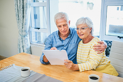 Buy stock photo Shot of a senior couple financial planning at home