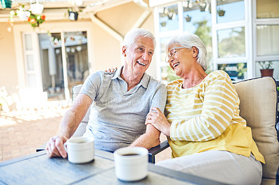 Buy stock photo Shot of a happy senior couple having a relaxing coffee break together in their backyard at home