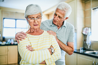 Buy stock photo Cropped shot of a senior man trying to console his upset wife