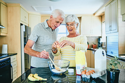 Buy stock photo Cropped shot of a senior couple baking together at home