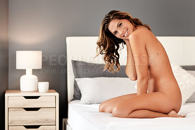 Buy stock photo Full length portrait of a gorgeous young woman smiling while posing naked on her bed at home