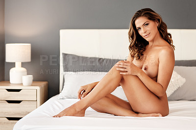 Buy stock photo Full length portrait of a gorgeous young woman posing naked on her bed at home