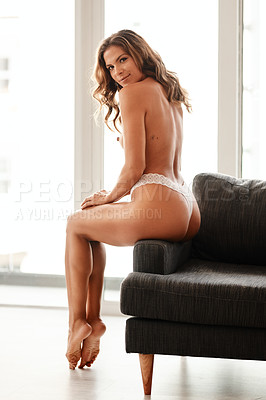 Buy stock photo Full length portrait of a gorgeous young woman sitting topless on a couch at home