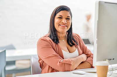 Buy stock photo Cropped portrait of an attractive young businesswoman sitting alone with her arms folded in her office