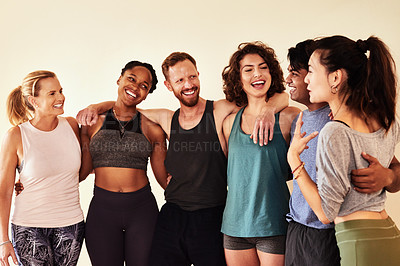 Buy stock photo Shot of a group of young men and women hanging out in yoga class