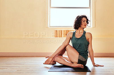 Buy stock photo Shot of a young woman practicing yoga