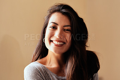 Buy stock photo Portrait of a beautiful young woman posing against a brown background