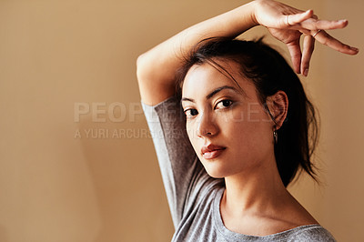 Buy stock photo Portrait of a young woman making a hand gesture during a yoga session