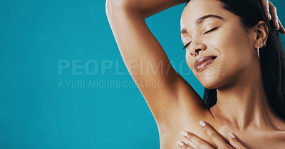 Buy stock photo Cropped shot of a beautiful young woman touching her underarms