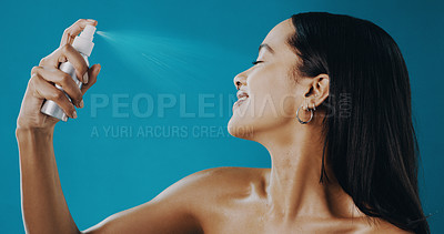 Buy stock photo Cropped shot of a beautiful young woman applying setting spray to her face