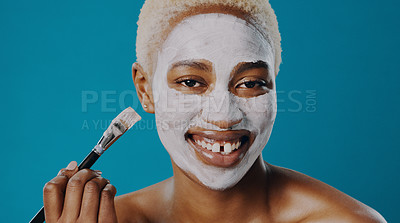 Buy stock photo Shot of a beautiful young woman giving herself a facial