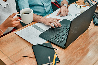 Buy stock photo Closeup shot of two architects working together on a laptop in an office