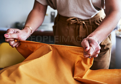 Buy stock photo Cropped shot of an unrecognizable designer working with fabric in her workshop