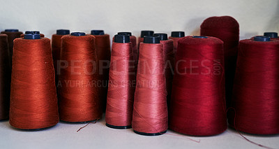 Buy stock photo Cropped shot of spools of thread in a workshop