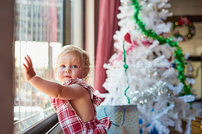 Buy stock photo Portrait of an adorable baby girl enjoying herself at home on Christmas day