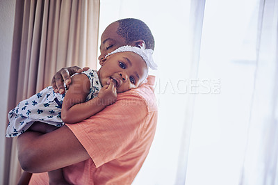 Buy stock photo Portrait of an adorable baby girl bonding with her father at home