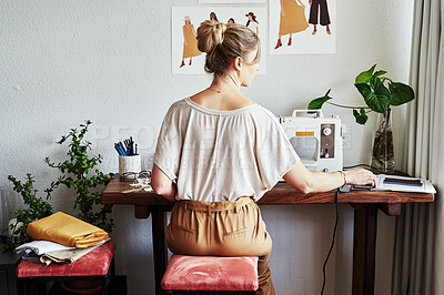 Buy stock photo Rearview shot of a fashion designer working in her workshop