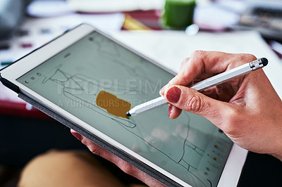 Buy stock photo Cropped shot of a fashion designer using a digital tablet to create new designs