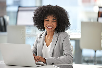 Buy stock photo Portrait of an attractive young businesswoman working on a laptop inside her office