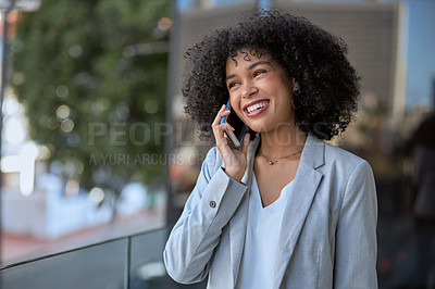 Buy stock photo Cropped shot of an attractive young businesswoman talking on her cellphone while standing outside her office building