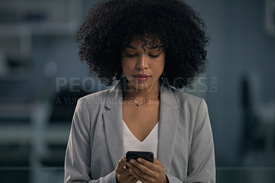 Buy stock photo Cropped shot of an attractive young businesswoman using her cellphone at work