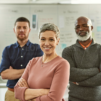 Buy stock photo Cropped shot of a diverse group of businesspeople standing together with their arms folded in the office