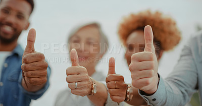 Buy stock photo Shot of a group of diverse businesspeople showing thumbs up in a modern office
