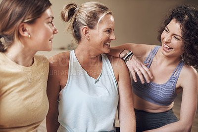 Buy stock photo Cropped shot of a young group of women sitting together and bonding during an indoor yoga session
