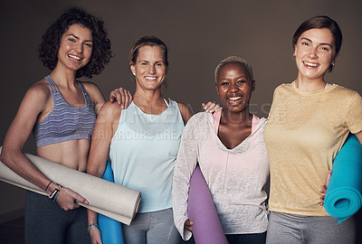 Buy stock photo Cropped portrait of a young group of woman sitting together and bonding during an indoor yoga session