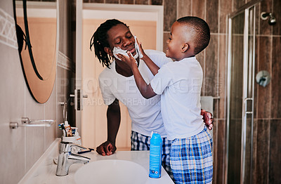 Buy stock photo Cropped shot of a young man and his son in the bathroom at home