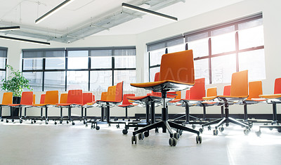Buy stock photo Shot of chairs in an an empty modern office