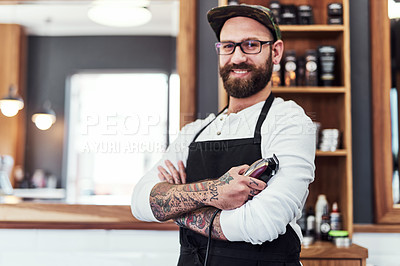 Buy stock photo Portrait of a handsome young barber posing with his arms folded inside his barbershop