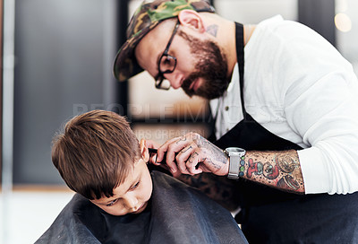 Buy stock photo Cropped shot an adorable little boy getting a haircut at the barbershop