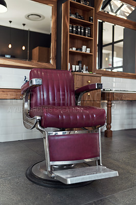 Buy stock photo Still life shot of barber chair inside an empty barbershop